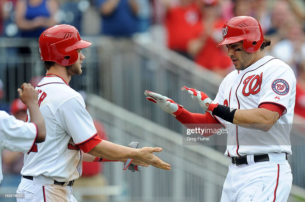 Michael Morse #38 of the Washington Nationals celebrates with <a gi-track='captionPersonalityLinkClicked' href=/galleries/search?phrase=Bryce+Harper&family=editorial&specificpeople=5926486 ng-click='$event.stopPropagation()'>Bryce Harper</a> #34 after hitting a home run in the eighth inning against the Philadelphia Phillies at Nationals Park on October 3, 2012 in Washington, DC.