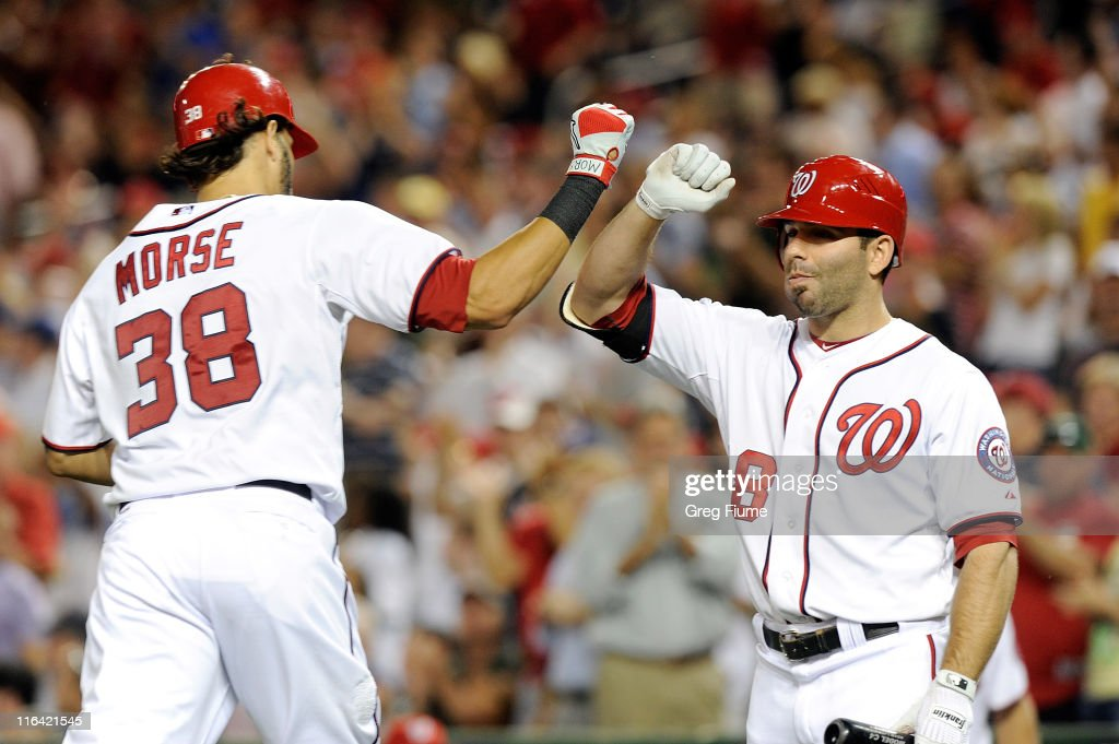 Michael Morse #38 of the Washington Nationals celebrates with Danny Espinosa #8 after hitting a home run in the seventh inning against the St. Louis Cardinals at Nationals Park on June 15, 2011 in Washington, DC. The Nationals won the game 10-0.