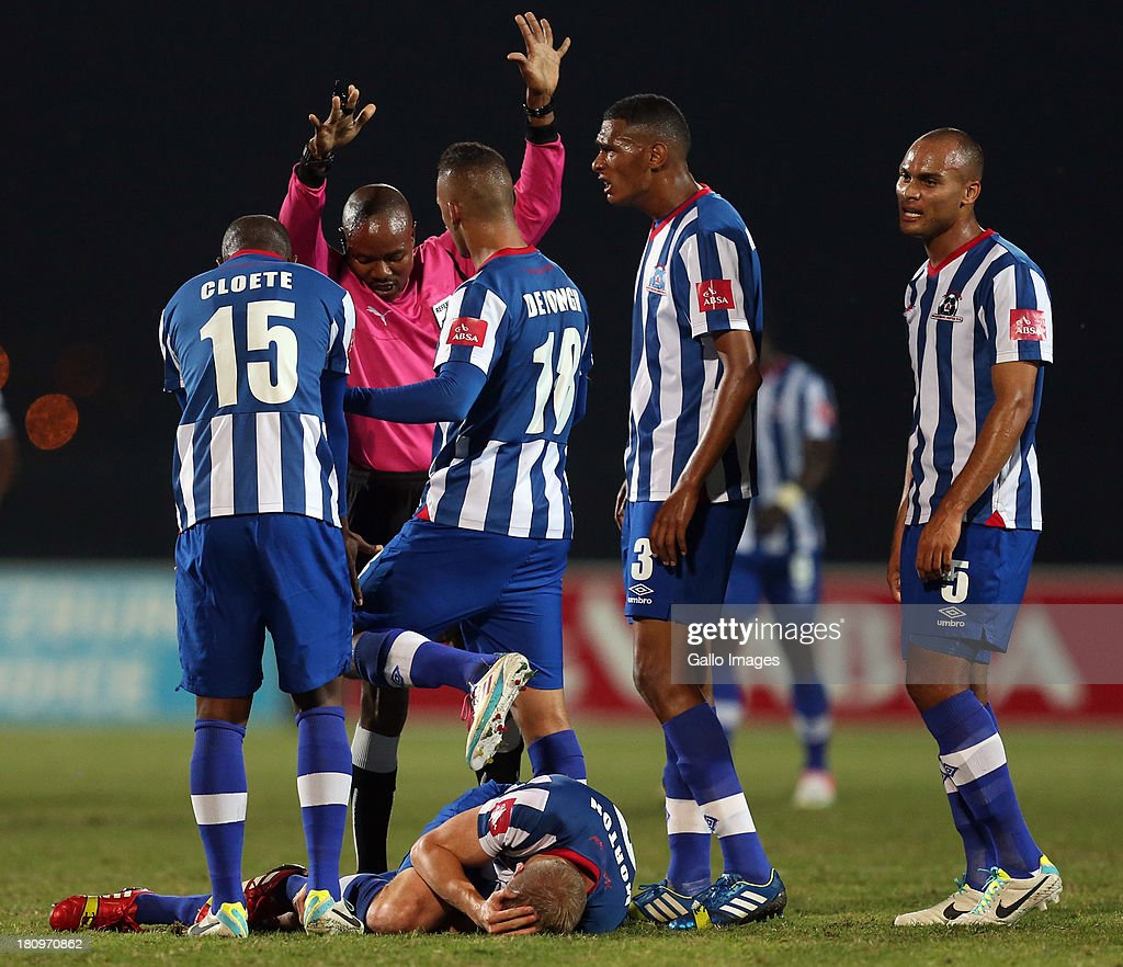Michael Morton Captain of Maritzburg Utd Lies on the ground injured during the Absa Premiership match between Maritzburg United and MP Black Aces at Harry Gwala Stadium on September 18, 2013 in Durban, South Africa.