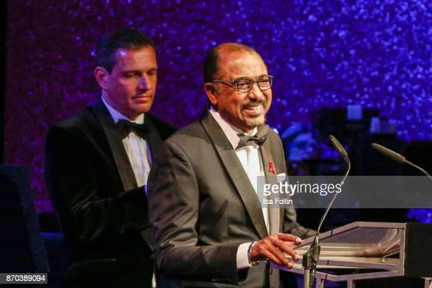 Michael Mronz and award winner Michel Sidibe during the 24th Opera Gala at Deutsche Oper Berlin on November 4 2017 in Berlin Germany