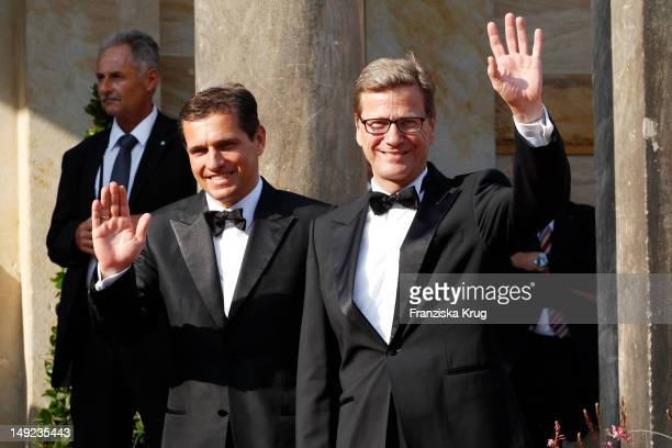 Michael Mronz and Guido Westerwelle arrive for the Bayreuth festival 2012 premiere on July 25 2012 in Bayreuth Germany