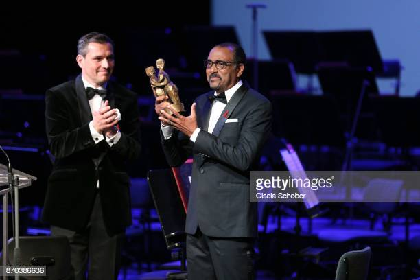 Michael Mronz and Michel Sidibe Unaids Executive Director with award during the 24th Opera Gala benefit to Deutsche AidsStiftung at Deutsche Oper...