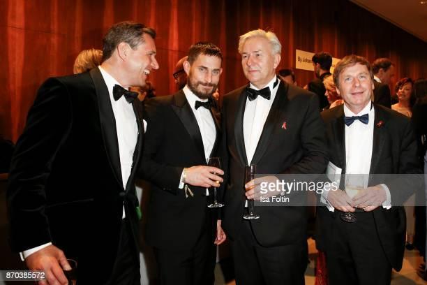 Michael Mronz German actor Clemens Schick former mayor of Berlin Klaus Wowereit and guest during the 24th Opera Gala at Deutsche Oper Berlin on...
