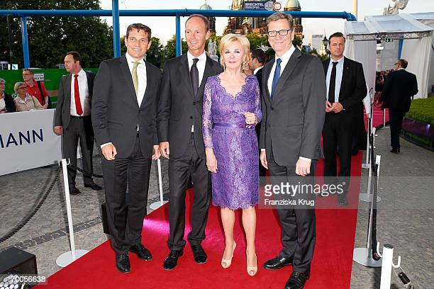 Michael Mronz Thomas Rabe Liz Mohn and Guido Westerwelle attend the Bertelsmann Summer Party at the Bertelsmann representative office on June 6 2013...