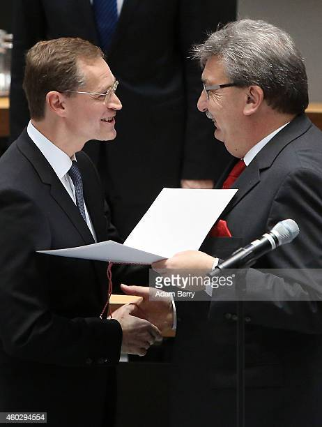 Michael Mueller designated mayor of the city of Berlin is sworn into office by Ralf Wieland president of the Berlin state parliament during a plenary...