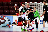 Michael Mueller of Germany and Patrick Wiencek of Germany defend against Bartosz Jurecki of Poland during the IHF Men's Handball World Championship...