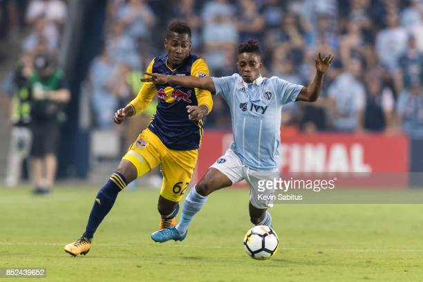 Michael Murillo of New York Red Bulls and Latif Blessing of Sporting Kansas City fight for the ball in the US Open Cup Final match at Children's...