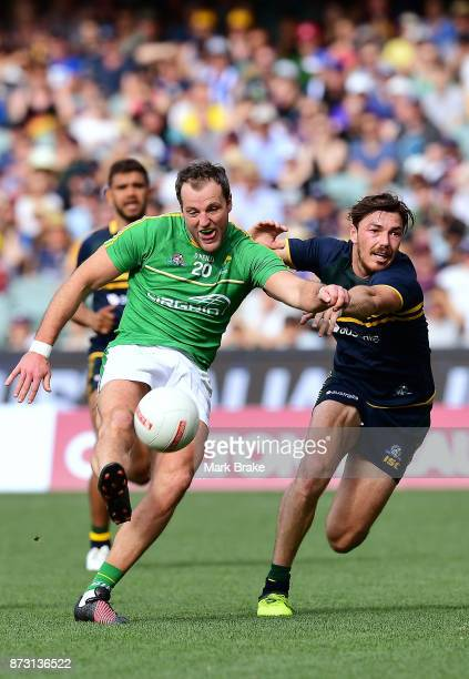 MIchael Murphy of Ireland kicks away from MIchael Hibberd of Australia during game one of the International Rules Series between Australia and...
