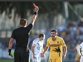 Michael Neill of the Mariners is given a red card by the referee during the round 22 ALeague match between the Central Coast Mariners and the...