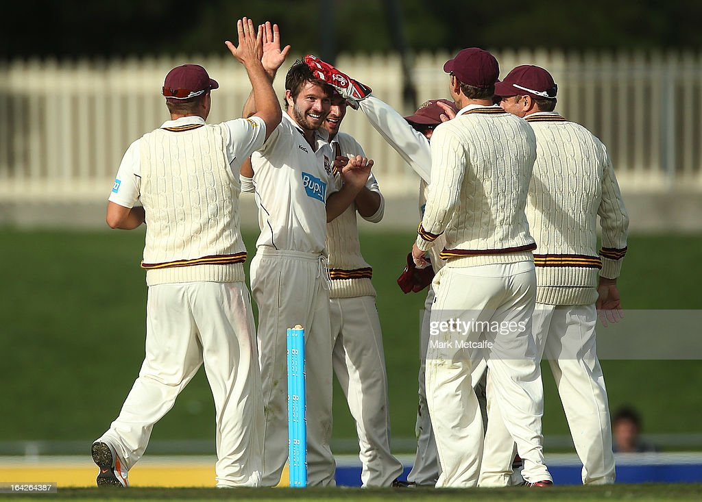 Michael Neser of the Bulls celebrates with teammates after taking the wicket of Mark Cosgrove of the Tigers during day one of the Sheffield Shield final between the Tasmania Tigers and the Queensland Bulls at Blundstone Arena on March 22, 2013 in Hobart, Australia.