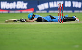Michael Neser of the Strikers reacts to being runout by Ben Rohrer of the Thunder during the Big Bash League match between the Sydney Thunder and...