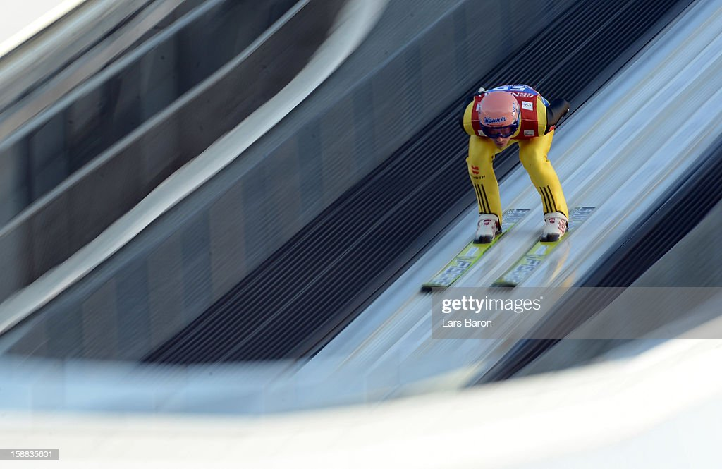 Michael Neumayer of Germany competes during the qualification round for the FIS Ski Jumping World Cup event at the 61st Four Hills ski jumping tournament at Olympiaschanze on December 31, 2012 in Garmisch-Partenkirchen, Germany.