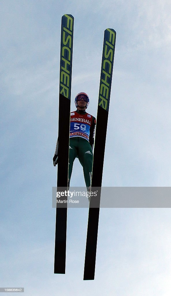 Michael Neumayer of Germany competes during the trial round for the FIS Ski Jumping World Cup event of the 61st Four Hills ski jumping tournament at Olympiaschanze on December 31, 2012 in Garmisch-Partenkirchen, Germany.