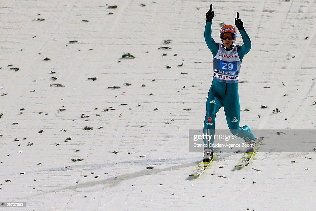 <a gi-track='captionPersonalityLinkClicked' href=/galleries/search?phrase=Michael+Neumayer&family=editorial&specificpeople=800790 ng-click='$event.stopPropagation()'>Michael Neumayer</a> of Germany reacts during the FIS Ski Jumping World Cup Vierschanzentournee (Four Hills Tournament) on December 29, 2013 in Oberstdorf, Germany.