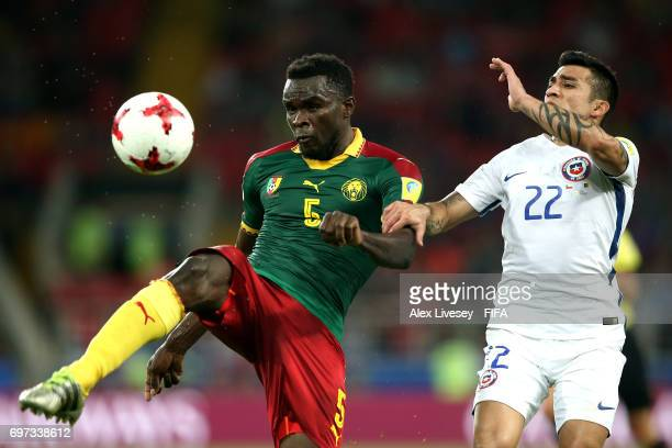 Michael NgadeuNgadjui of Cameroon clears the ball while under pressure from Edson Puch of Chile during the FIFA Confederations Cup Russia 2017 Group...