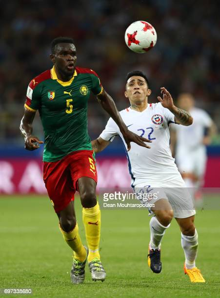Michael NgadeuNgadjui of Cmeroon and Edson Puch of Chile battle for possession during the FIFA Confederations Cup Russia 2017 Group B match between...