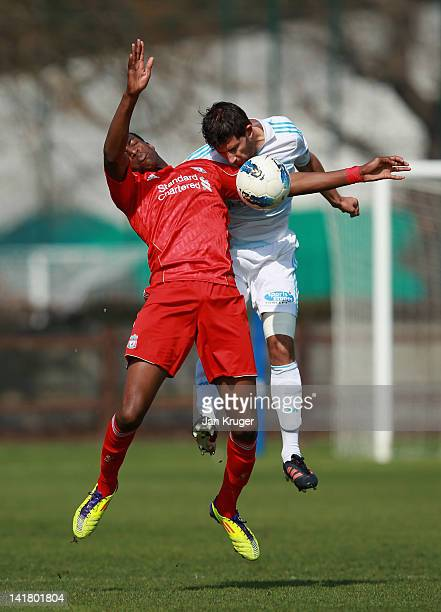 Michael Ngoo of Liverpool and Arnaud Cesarini of Marseille jump for the ball during the NextGen Series 3rd Place Play Off final match between...
