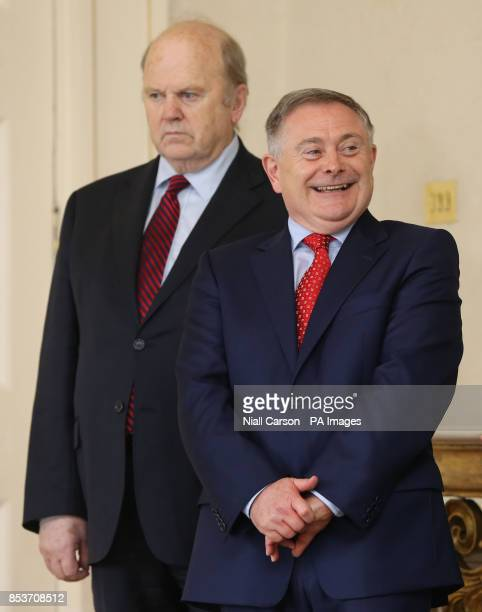 Michael Noonan and Brendan Howlin watch as their colleagues receive their Ministerial Seals of Office at Aras an Uachtarain Dublin after today's...