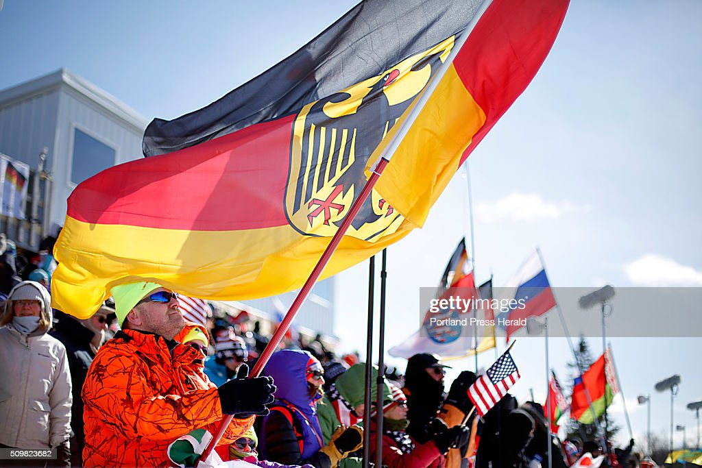 Michael Norman of Dresden, Germany, waves a German flag at the start of the men's 12.5-kilometer pursuit at the BMW IBU World Cup Biathlon at the Nordic Heritage Center in Presque Isle, Friday, February 12, 2016. Norman brought his wife Stephanie and daughter Michaela, 7, with him to Presque Isle from Germany just for the World Cup. He was very excited to be at an arena where the spectators are allowed so close to the firing range, unlike the one closest to him in Germany, he said.