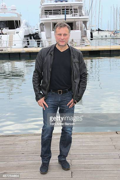 Michael Nyqvist poses during the '100 Code' photocall at Mipcom 2014 on October 13 2014 in Cannes France