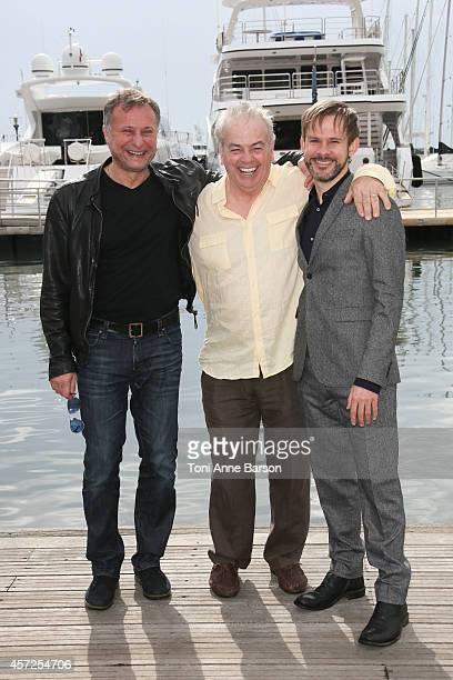 Michael Nyqvist Robert Moresco and Dominic Monaghan pose during the '100 Code' photocall at Mipcom 2014 on October 13 2014 in Cannes France