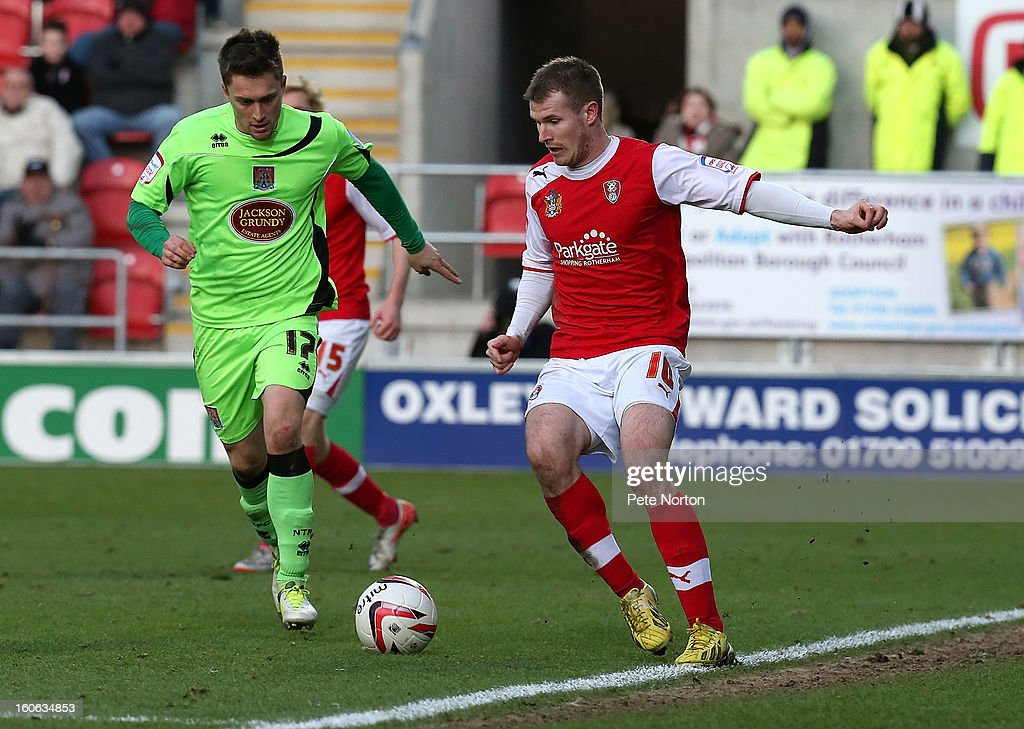 Michael O'Connor (R) of Rotherham United looks to play the ball watched by Jake Robinson of Northampton Town during the npower League Two match between Rotherham United and Northampton Town at New York Stadium on February 2, 2013 in Rotherham, England.