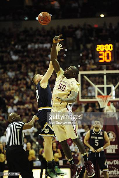Michael Ojo center Florida State University Seminoles taps the tipoff to a temmate against the Notre Dame Fighting Irish in an Atlantic Coast...