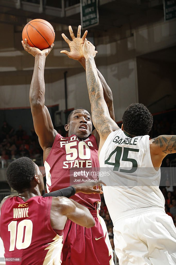 Michael Ojo #50 of the Florida State Seminoles misses his shot while being defended by Julian Gamble #45 of the Miami Hurricanes on January 27, 2013 at the BankUnited Center in Coral Gables, Florida. The Hurricanes defeated the Seminoles 71-47.