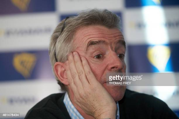 Michael O'Leary CEO of Irish lowcost carrier Ryanair gestures during a press conference on January 13 2015 at the Hahn airport in Lautzenhausen...