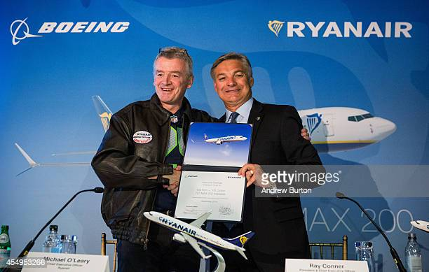 Michael O'Leary CEO of Ryanair and Ray Conner President and CEO of The Boeing Company shake hands after signing a contract announcing the first sales...