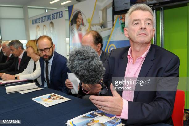 Michael O'Leary chief executive officer of Ryanair Holdings Plc handles a microphone ahead of the company's annual general meeting in Dublin Ireland...