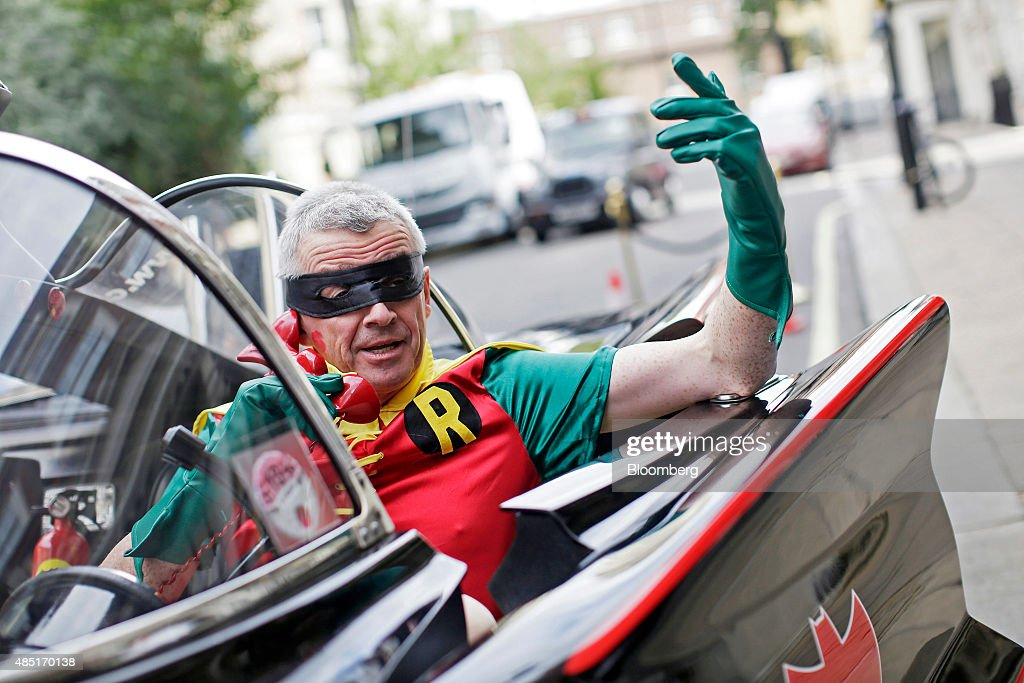Michael O'Leary, chief executive officer of Ryanair Holdings Plc, dressed as superhero side-kick Robin poses for a photograph in a replica Batmobile vehicle ahead of a news conference in London, U.K., on Tuesday, Aug. 25, 2015. O'Leary launched Ryanair Car Hire in partnership with CarTrawler. Photographer: Matthew Lloyd/Bloomberg via Getty Images