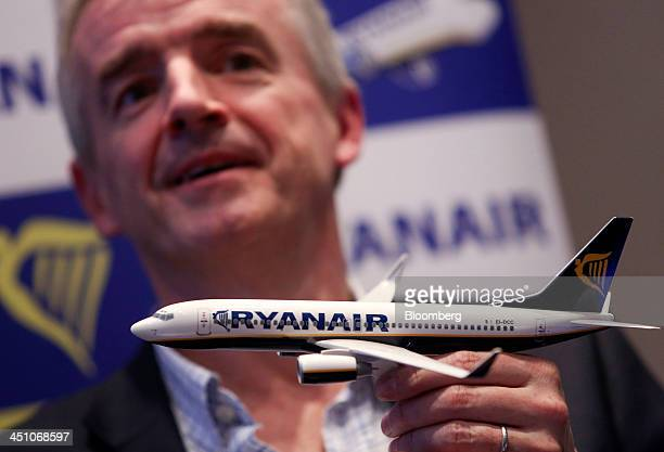 Michael O'Leary chief executive officer of Ryanair Holdings Plc holds a model aircraft as he speaks during a news conference in London UK on Thursday...