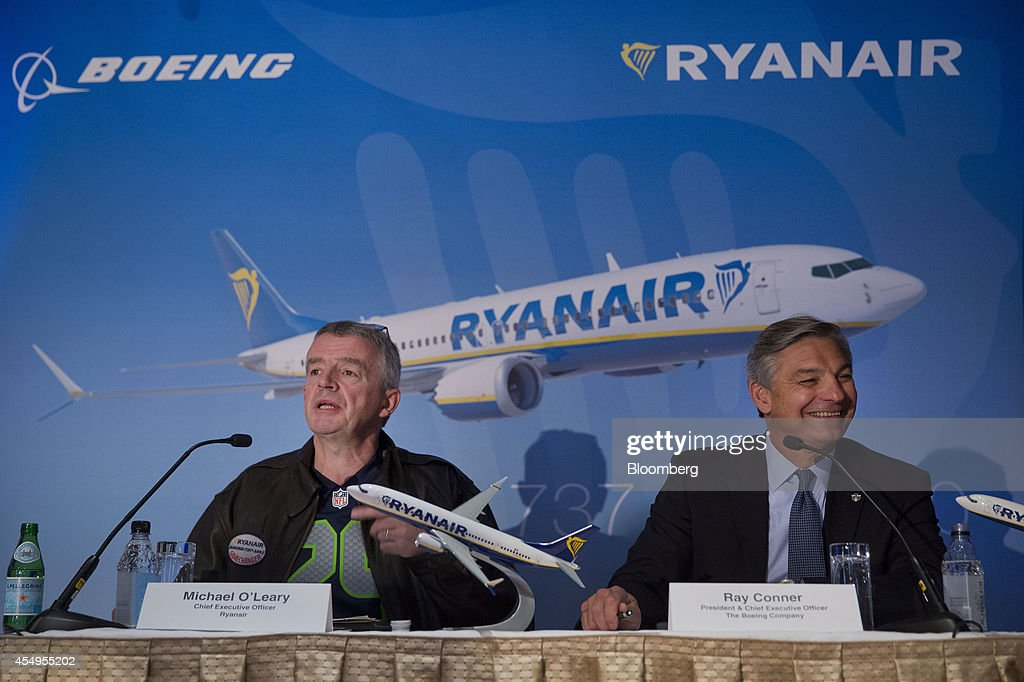 Michael O'Leary, chief executive officer of Ryanair Holdings Plc, left, speaks as Ray Conner, chief executive officer of Boeing Commercial Airplane Group, smiles during a news conference in New York, U.S., on Monday, Sept. 8, 2014. Ryanair Holdings Plc agreed to buy as many as 200 Boeing Co. 737 Max jets valued at $22 billion at list price after pushing the planemaker to develop a new version that squeezes in more seats. Photographer: Jin Lee/Bloomberg via Getty Images