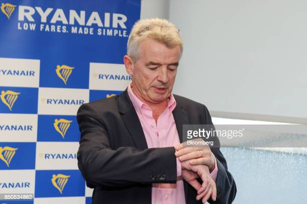 Michael O'Leary chief executive officer of Ryanair Holdings Plc looks at his watch ahead of the company's annual general meeting in Dublin Ireland on...