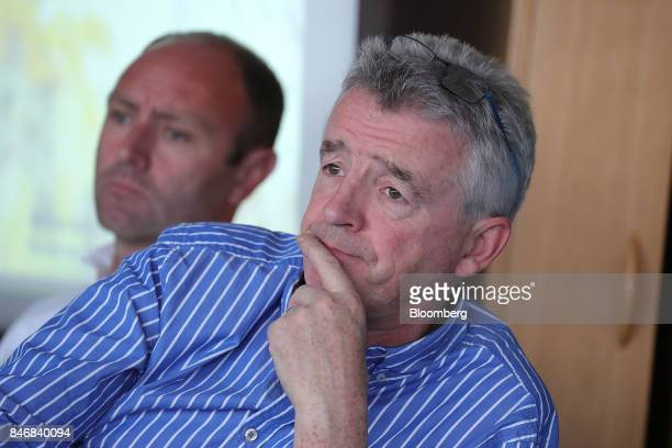 Michael O'Leary chief executive officer of Ryanair Holdings Plc right looks on as he sits beside Kenny Jacobs chief marketing officer of Ryanair...