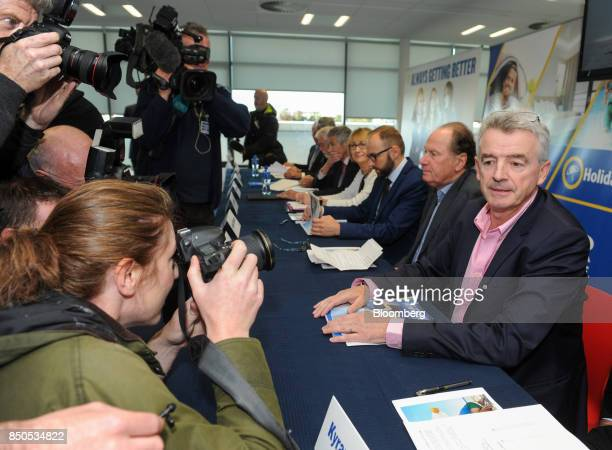 Michael O'Leary chief executive officer of Ryanair Holdings Plc attends the company's annual general meeting in front of a group of photographers and...