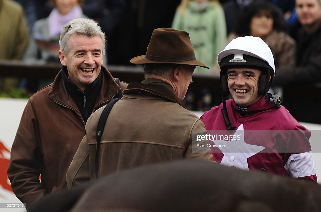 Michael O'Leary (L) with Ruby Walsh (R) and Willie Mullins (C) laugh after Analifet wins at Fairyhouse racecourse on December 01, 2013 in Ratoath, Ireland.