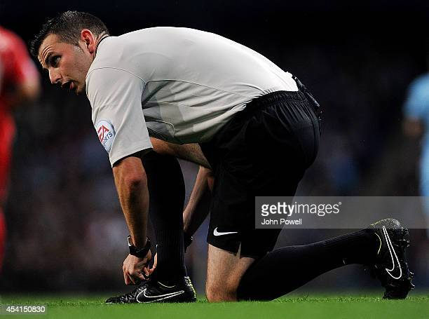 Michael Oliver referee during the Barclays Premier Leauge match between Manchester City and Liverpool at Etihad Stadium on August 25 2014 in...