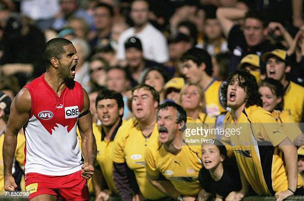 Michael O'Loughlin of the Swans screams at the Eagles supporters after kicking the winning goal during the AFL First Qualifying Final between the...