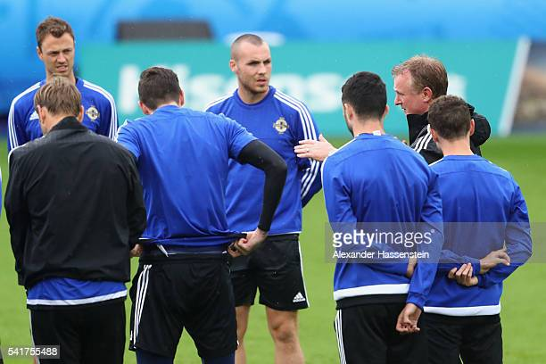 Michael O'Neill head coach of Northern Ireland talks to his palyer during a team Northern Ireland training session ahead of the UEFA EURO 2016 Group...