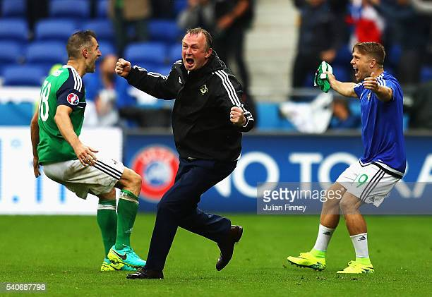 Michael O'Neill manager of Northern Ireland celebrate his team's second goal with Aaron Hughes and Jamie Ward during the UEFA EURO 2016 Group C match...