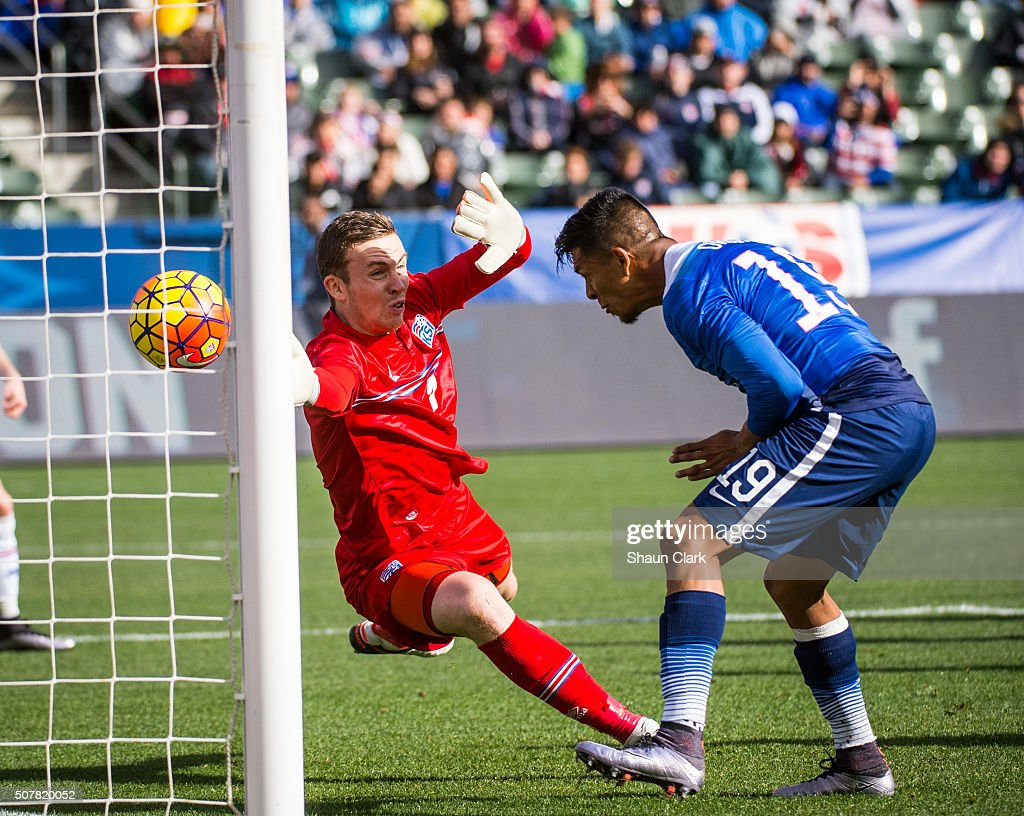 Michael Orozco of the United States heads home a goal as Ogmundur Kristinsson of Iceland attempts to block it during the International Soccer...