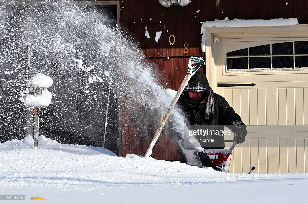 Michael Ostrander attempts to make his way through nearly five feet of snow on November 19 2014 in the Lakeview neighborhood of Buffalo New York The...