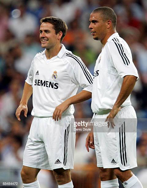 Michael Owen and Ronaldo smile during a Santiago Bernabeu Trophy friendly soccer match between Real Madrid and a US Major League Soccer allstar...