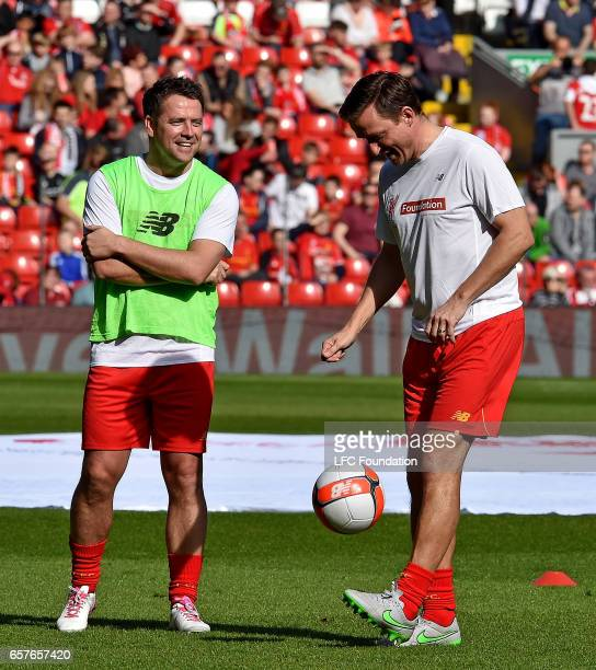 Michael Owen and Vladimir Smicer of Liverpool Legends before the LFC Foundation Charity Match between Liverpool Legends and Real Madrid Legends at...