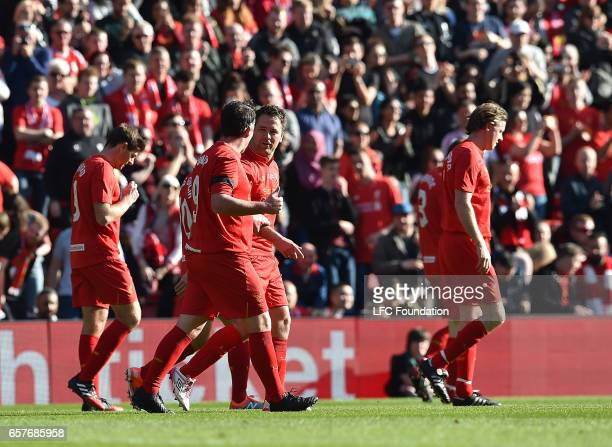 Michael Owen Celebrates his Goal For Liverpool Legends during the LFC Foundation Charity Match between Liverpool Legends and Real Madrid Legends at...