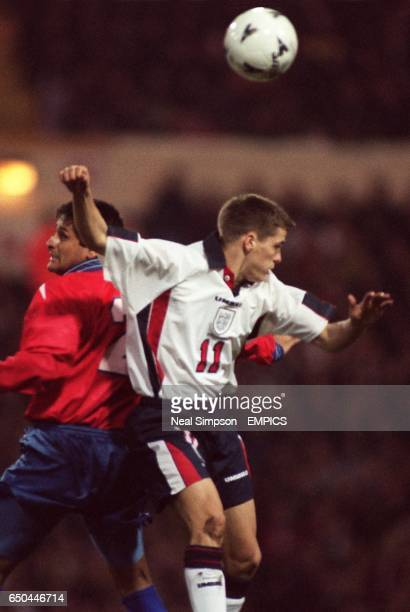Michael Owen in his debut for England battles for the ball with Chile's Ronald Fuentes