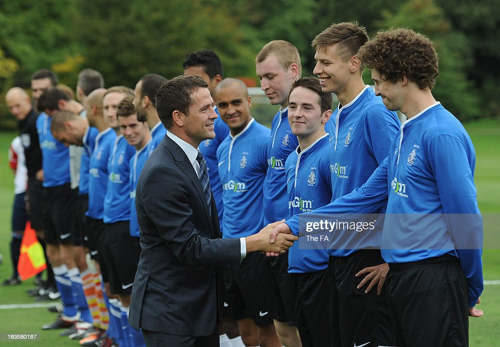 Michael Owen meets the teams before the first ever football match at Buckingham Palace between Civil Service FC and Polytechnic FC as part of The FA's 150th anniversary and an awards ceremony celebrating football's grassroots heroes at Buckingham Palace on October 7, 2013 in London, England.