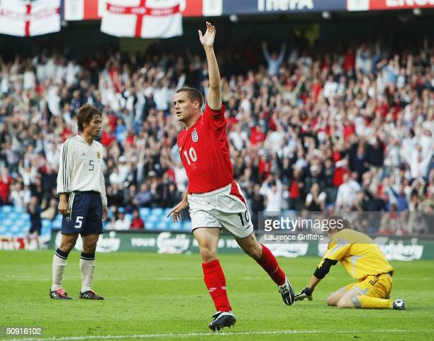 Michael Owen of England celebrates scoring the opening goal during the match between England and Japan held at the City of Manchester Stadium on June...